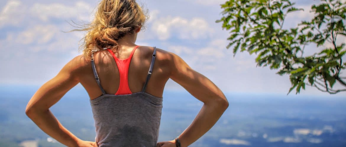 athletic woman's back outdoors wearing promo products for the athlete